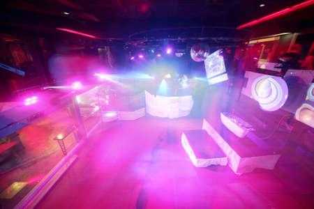 european stylish night club with bright lights photo