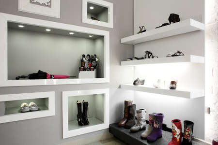 lighting background: Bright large shoe store with new collection