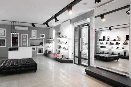 Bright large shoe store with new collection photo