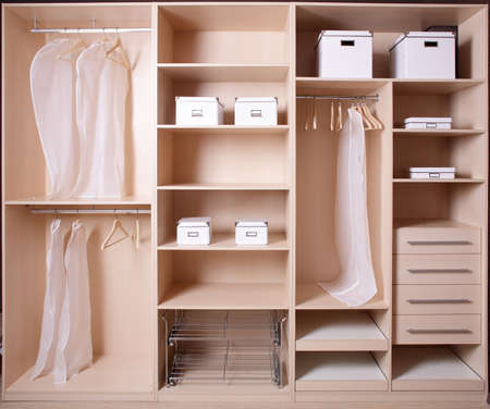 walk in closet: modern and stylish interior of bright wooden wardrobe