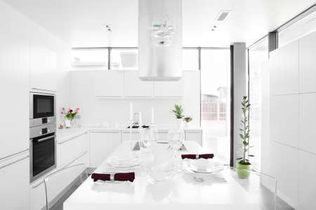 luxury white kitchen interior with modern furniture