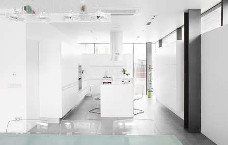 luxury white kitchen interior with modern furniture photo