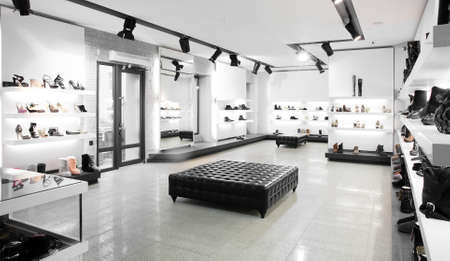 shop interior: Bright large shoe store with new collection