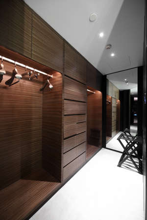 walk in closet: beautiful and modern interior of bright cloakroom