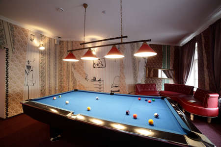 snooker room: brand new and modern billiard interior in night time