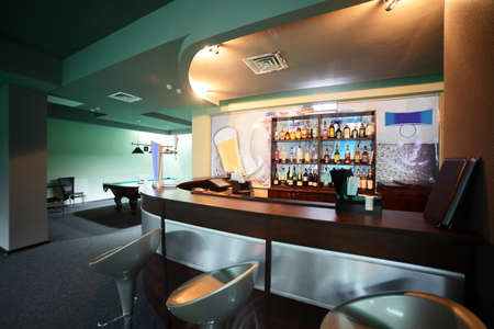 brand new and modern billiard interior in night time photo