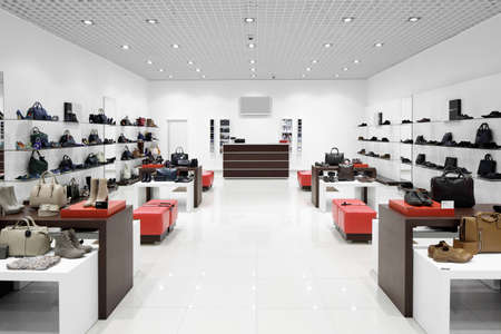 store interior: bright and fashionable interior of shoe store in modern mall