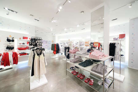 traditional clothes: luxury and fashionable brend new interior of cloth store