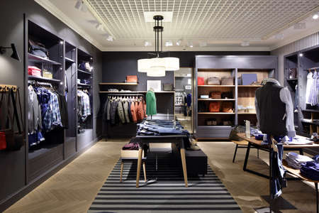 clothing stores: luxury and fashionable brend new interior of cloth store