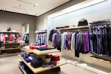 boutique shop: interior of brand new fashion clothes store