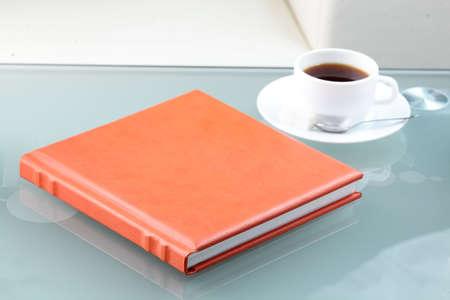 orange leather book on bright background photo