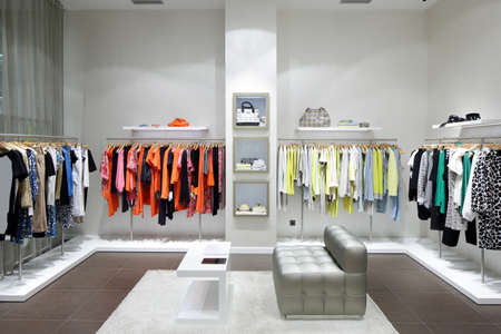 luxury and fashionable brand new interior of cloth store photo
