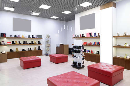 bright and fashionable interior of shoe store in modern mall photo