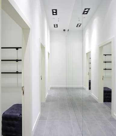 beautiful and clean interior of dressing room at the store photo