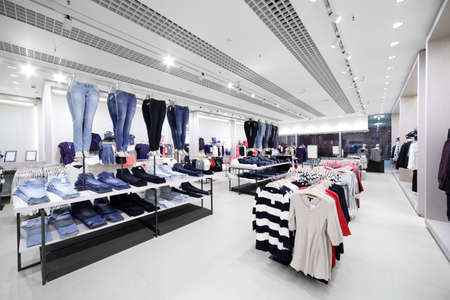 shelves: luxury and fashionable brand new interior of cloth store