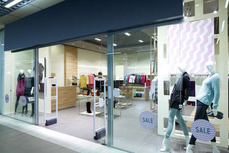 clothing store: bright and fashionable window of modern european store