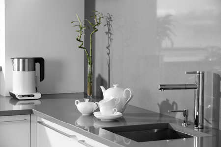 stainless steel water tap in modern interior photo