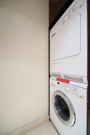 drying and washing machines in modern bright interior photo