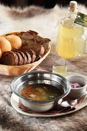 russian hot soup with bread and home alcohol on wooden background photo