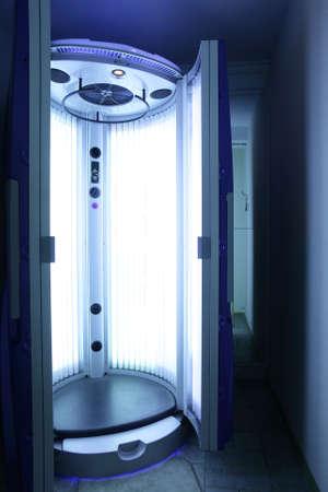 sun tanning: bright and colorful interior of european solarium Stock Photo