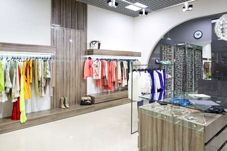 white clothing: luxury and fashionable brand new interior of cloth store