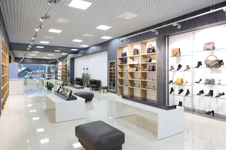 bright and fashionable interior of shoe store in modern mall Reklamní fotografie - 31384049