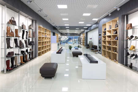 commercial: bright and fashionable interior of shoe store in modern mall