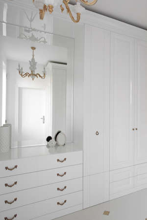 walk in closet: modern and stylish interior of bright wooden wardrobe