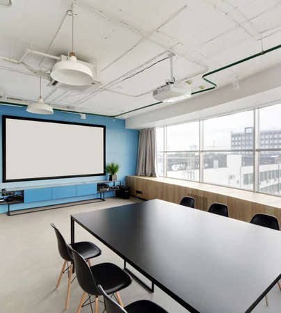 meeting room with projector in modern office