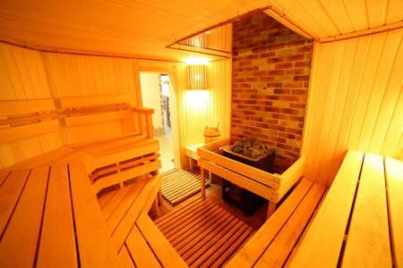 bright and hot interior of modern russian sauna photo