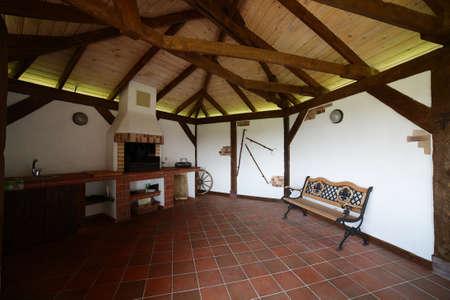 cozy light veranda in modern wooden house photo
