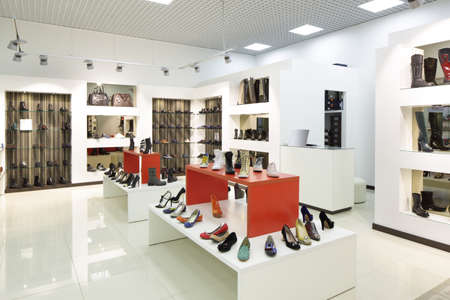 interior accessories: bright and fashionable interior of shoe store in modern mall