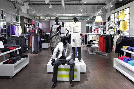 shop interior: luxury and fashionable brand new interior of cloth store