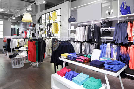 business fashion: luxury and fashionable brand new interior of cloth store