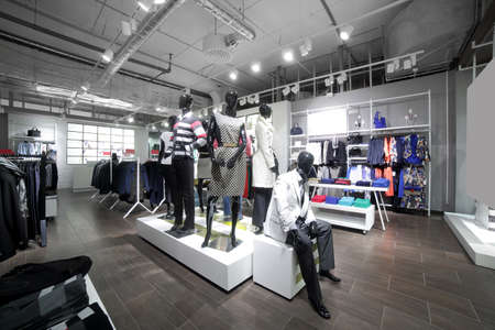 retail display: luxury and fashionable brand new interior of cloth store