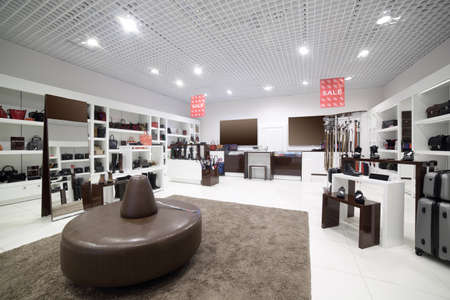 furniture shop: bright and fashionable interior of shoe store in modern mall