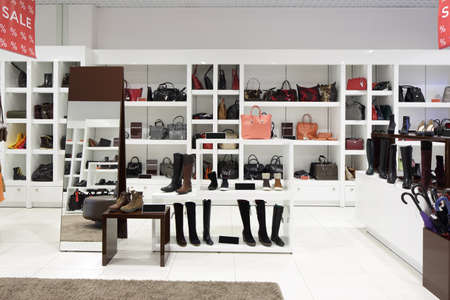 store display: bright and fashionable interior of shoe store in modern mall
