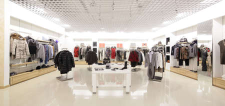 luxury and fashionable brand new interior of cloth store Banco de Imagens - 34259568