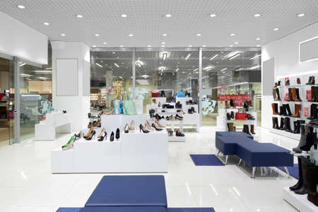 shoe store: bright and fashionable interior of shoe store in modern mall