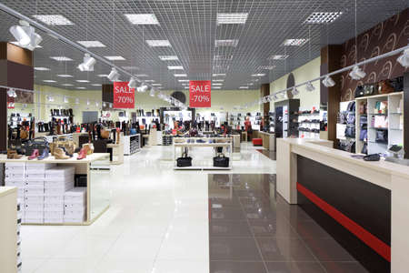 store: bright and fashionable interior of shoe store in modern mall