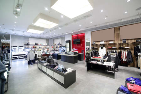 clothing: luxury and fashionable brand new interior of cloth store