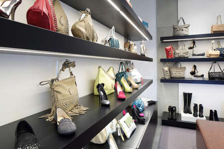 fashion design: bright and fashionable interior of shoe store in modern mall