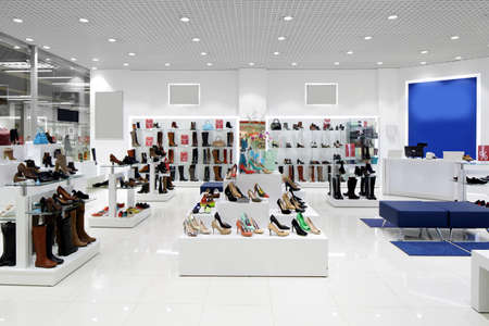 department: bright and fashionable interior of shoe store in modern mall
