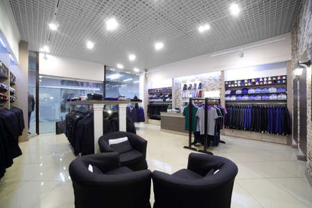 retailer: luxury and fashionable brand new interior of cloth store