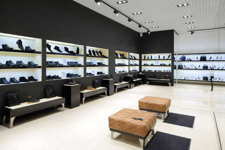 lighting background: bright and fashionable interior of shoe store in modern mall