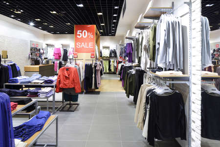 sale shop: luxury and fashionable brand new interior of cloth store