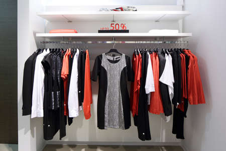 white clothes: luxury and fashionable brand new interior of cloth store