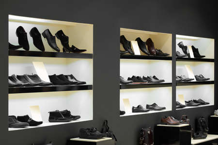 clothing stores: bright and fashionable interior of shoe store in modern mall