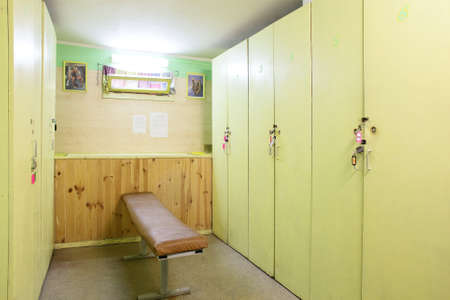 bright and modern dressing room in gym