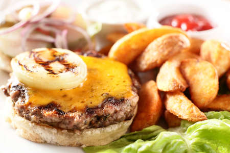 hot and tasty burger with meat potato and greens